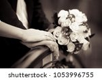 the bride's hand lies on the... | Shutterstock . vector #1053996755