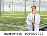 happy young agro engineer in... | Shutterstock . vector #1054001726