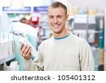 A young patient at the pharmacy - stock photo