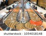 conveyor belt sushi in japan... | Shutterstock . vector #1054018148