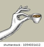 woman's hand with a small... | Shutterstock . vector #1054031612