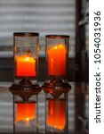 Small photo of Big candles in the dark room, power failure or emergency. Natural light, seletcive focus.