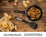 fried chanterelles on an old...   Shutterstock . vector #1054055966