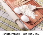 cutting board with eggs and a... | Shutterstock . vector #1054059452