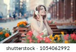 young woman listen to music on...   Shutterstock . vector #1054062992