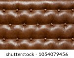 brown leather upholstery sofa ... | Shutterstock . vector #1054079456