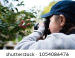 little girl to take a picture | Shutterstock . vector #1054086476
