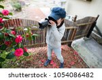 little girl to take a picture | Shutterstock . vector #1054086482