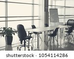 unoccupied office space with... | Shutterstock . vector #1054114286