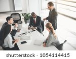 group of people sitting in the... | Shutterstock . vector #1054114415