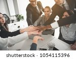 group of young workers in... | Shutterstock . vector #1054115396