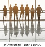 backs of calm people in... | Shutterstock . vector #1054115402
