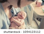 baby and mother in hospital.... | Shutterstock . vector #1054123112