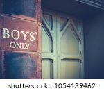 Small photo of Retro Vintage Boys' Only Sign On An Old Victorian Private School In The UK