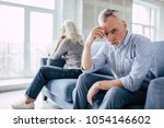 senior couple at home. handsome ... | Shutterstock . vector #1054146602