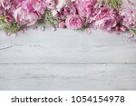pink peonies and roses on a... | Shutterstock . vector #1054154978