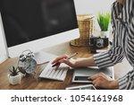 young female designer using... | Shutterstock . vector #1054161968