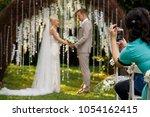 woman making promo videoblog or ... | Shutterstock . vector #1054162415