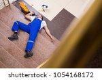 dead contractor worker felling...   Shutterstock . vector #1054168172