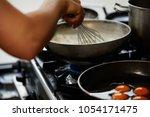 making gravy and whisking | Shutterstock . vector #1054171475