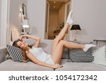 cheerful laughing girl in white ... | Shutterstock . vector #1054172342