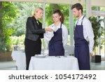 manager instructing restaurant... | Shutterstock . vector #1054172492