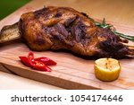 a large piece of lamb on the... | Shutterstock . vector #1054174646