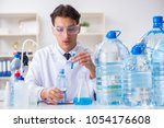 lab assistant testing water... | Shutterstock . vector #1054176608