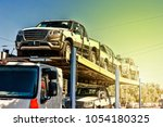 transportation of new cars | Shutterstock . vector #1054180325