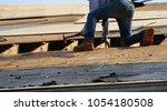 handyman working on repairing... | Shutterstock . vector #1054180508