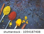 tea spoons full of spices  on... | Shutterstock . vector #1054187408