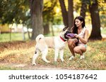 beautiful woman playing with a... | Shutterstock . vector #1054187642