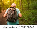 middle aged man hiking in the... | Shutterstock . vector #1054188662