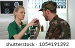 Medical Doctor Woman Talk to Soldier about Ultrasound Image in Hospital Room, Healthcare Activity Concept
