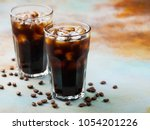 ice coffee in a tall glass with ... | Shutterstock . vector #1054201226