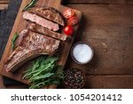grilled cowboy beef steak ... | Shutterstock . vector #1054201412
