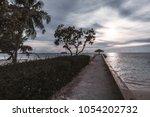 long empty concrete pier with... | Shutterstock . vector #1054202732