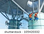 a man cleaning windows on a... | Shutterstock . vector #105420332