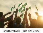 Stock photo rising up brazil flags crowd of people holding brazilian flags back view 1054217222