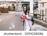 beautiful girl in a street | Shutterstock . vector #1054228286