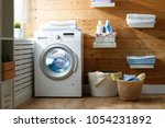 Stock photo interior of a real laundry room with a washing machine at the window at home 1054231892