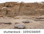 sedimentary sand and rocks on... | Shutterstock . vector #1054236005