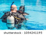 diving instructor and students. ... | Shutterstock . vector #1054241195