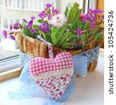 Decoration floral composition in a small basket a hyacinths bellis and primrose Spring flowers on a balcony - stock photo
