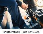 closeup man drives a reliable... | Shutterstock . vector #1054248626