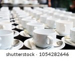 group of empty cups in many... | Shutterstock . vector #1054282646