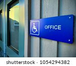 Small photo of Sign denoting a disabled accessible office.