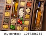 various pasta in wooden box and ... | Shutterstock . vector #1054306358
