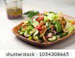 vegetarian fattoush salad lunch.... | Shutterstock . vector #1054308665