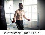 boxer preparing for a hard... | Shutterstock . vector #1054317752